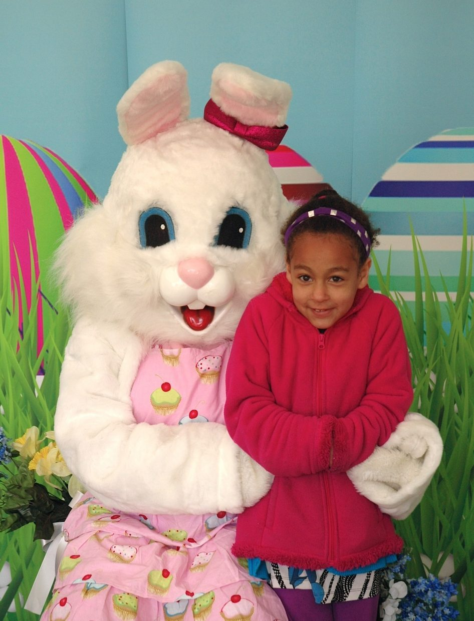 In this photo: Alina Grant stands next to the Easter bunny (Amanda Bartkoski)