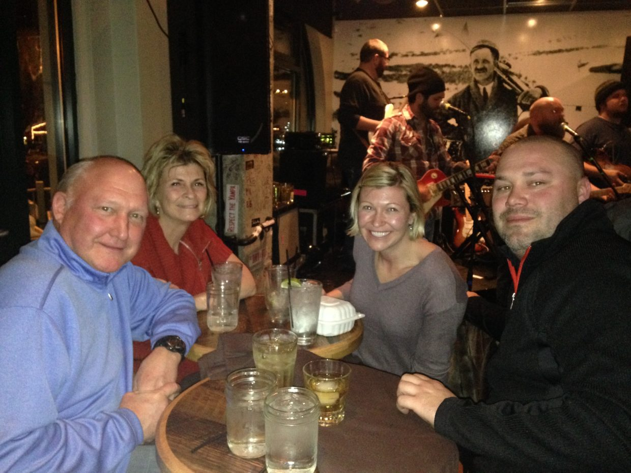 Don Johnson, Mary John, Josh Knurr and Megan Knurr, from left, listened to the music of Johnny Campbell and the Bluegrass Drifters.