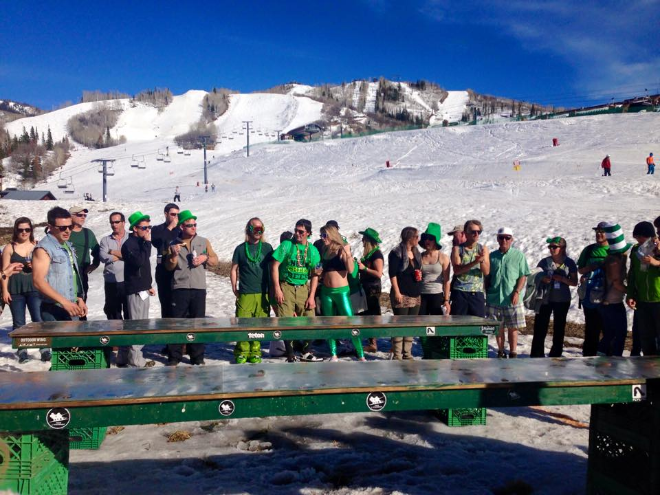At the T-Bar, skiers and snowboarders take part in festivities for St. Patrick's Day.