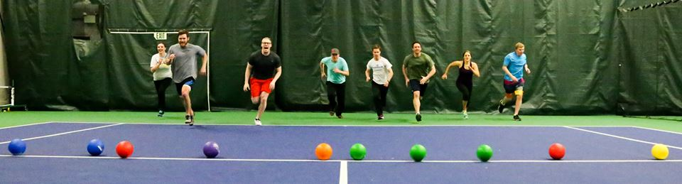 A group of YPN members get ready to start a round of dodgeball.
