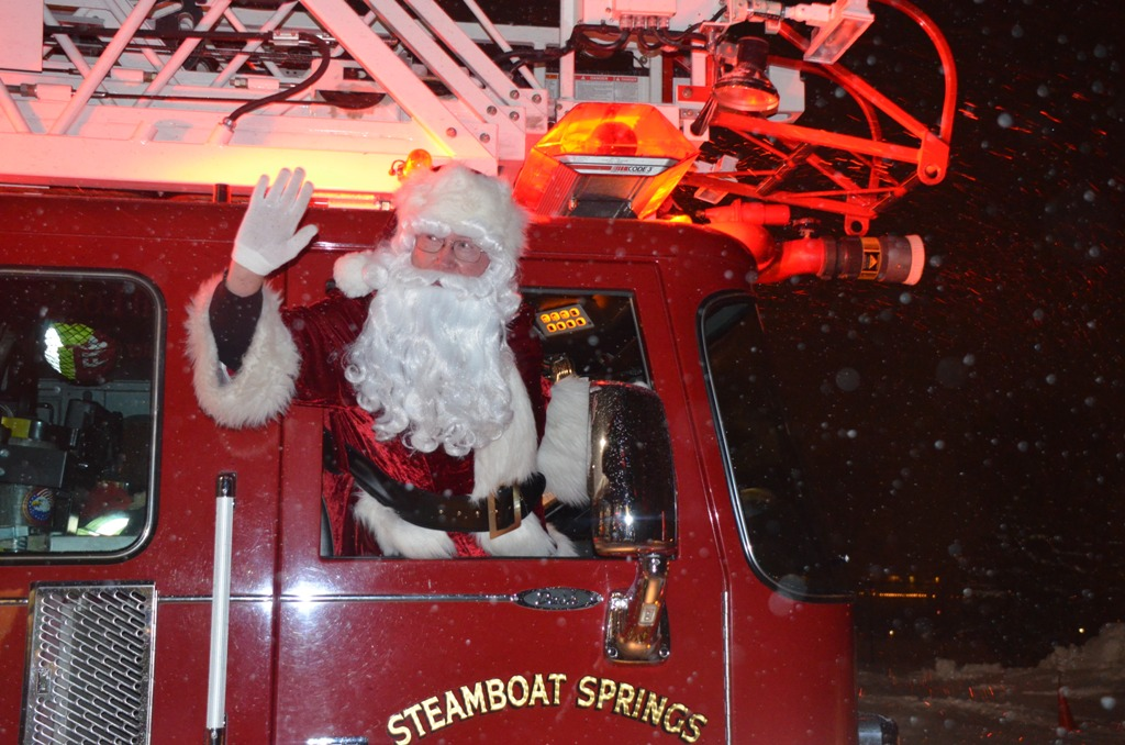 Santa Claus waves to the crowds of kids who anxiously awaited his arrival at last Sunday's Community Holiday Party at Howelsen Hill. He arrived riding on a Steamboat Springs Fire Rescue fire truck.