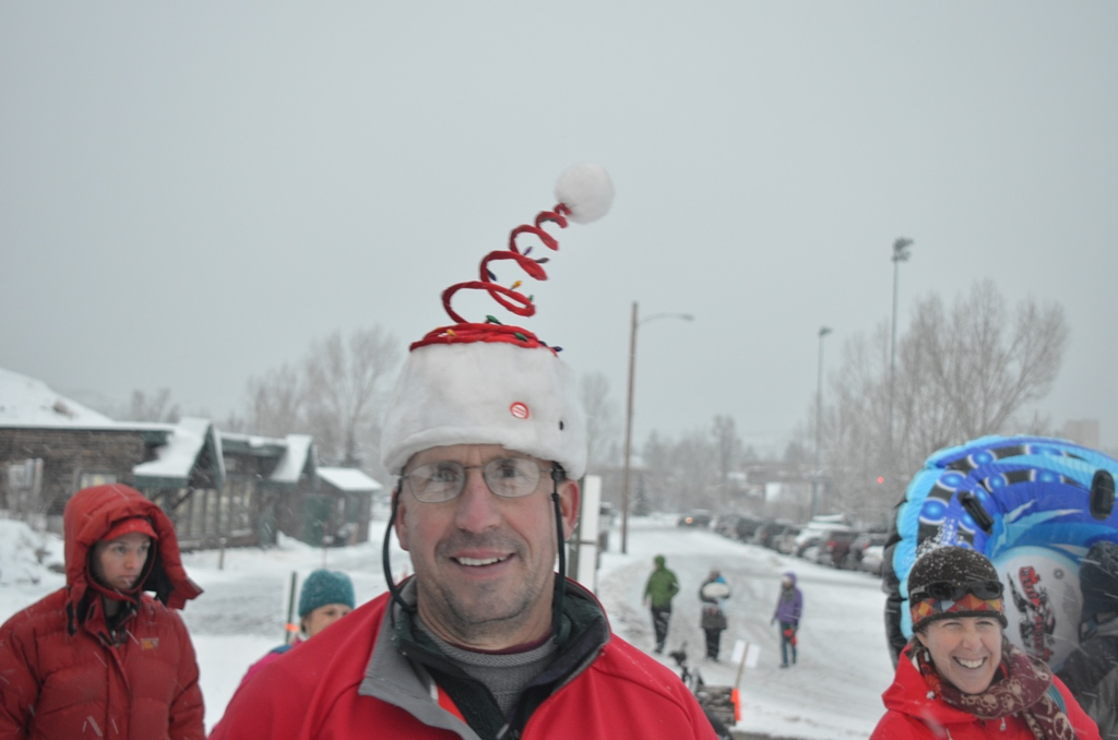 Rotarian Chris Stillwell dressed for the occasion and served hot chocolate outdoors at Sunday's Community Holiday Party.