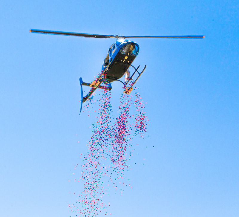 At the annual Easter Eggstravaganza event a helicopter delivers more eggs onto a drop pit.