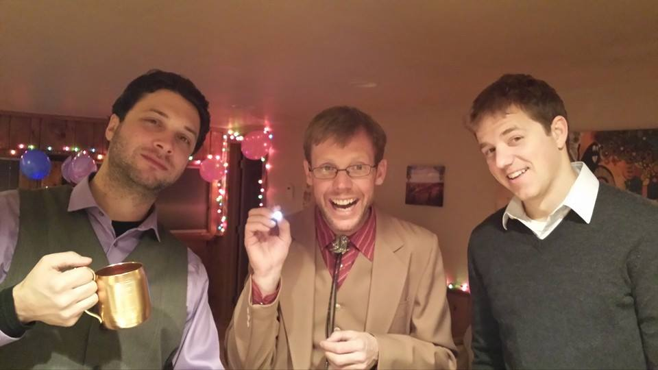 Ryan Duke, Josh Westfall and Sean Schimmel pose for a photo at a friend's house to ring in the new year.