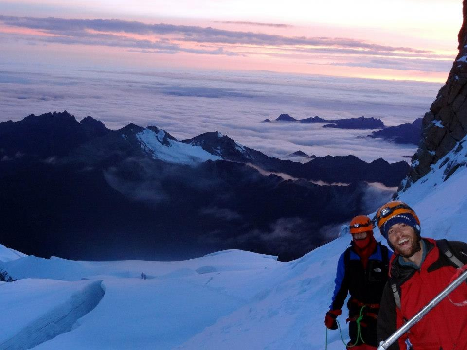 Looking out over the towering peaks of the Andes Mountains, Greg Johnson and friends pose for a photo on their ascent to Huayna Potosi when they were living in Bolivia.