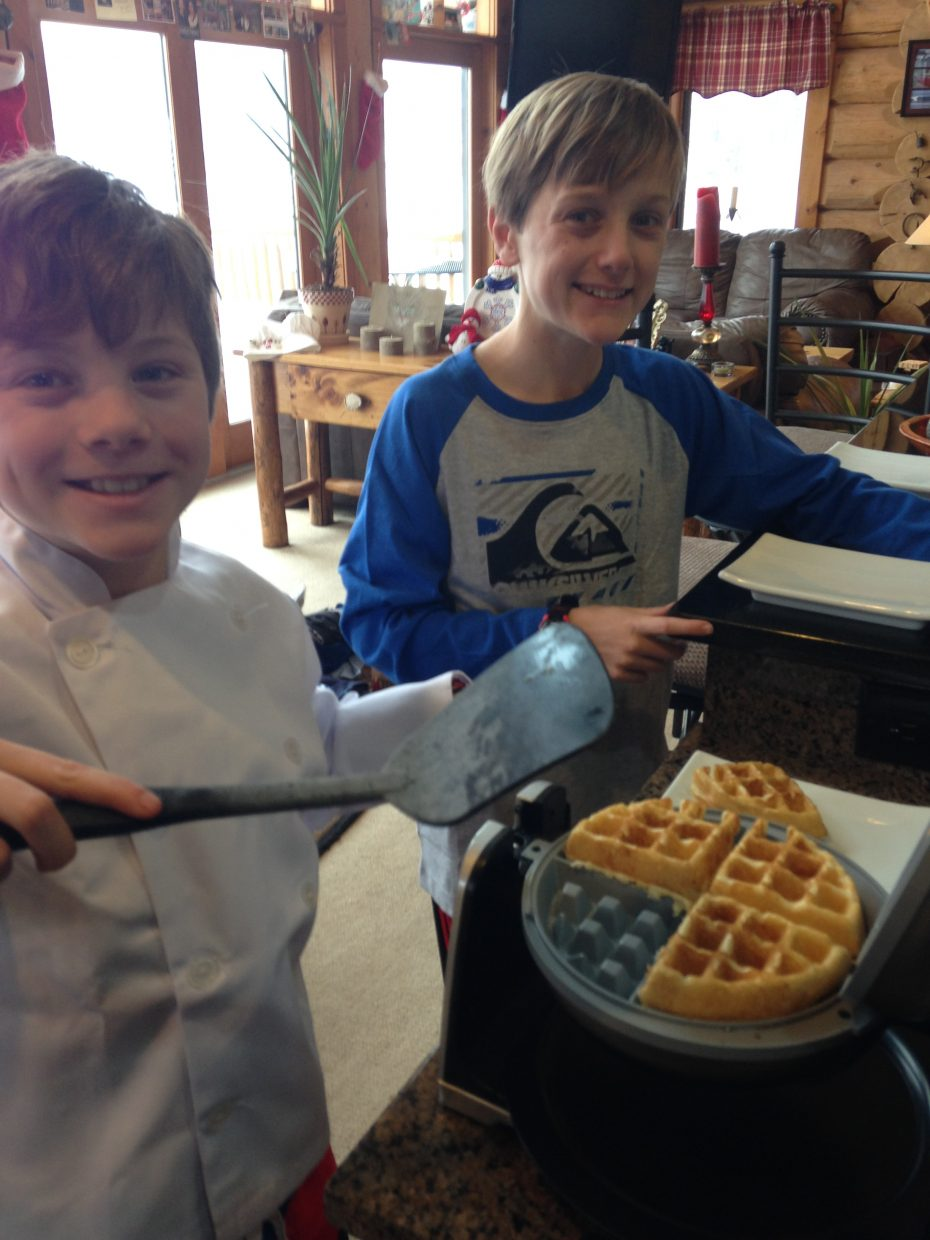 Shari Fryer's christmas traditions include cooking with her family. Here her sons Jaydon and Jaxson are cooking up their dishes for their big holiday meal.