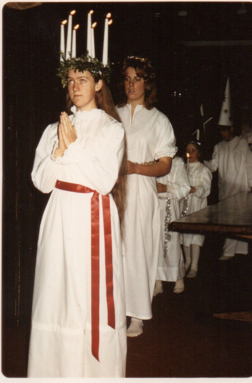 Birgitta Lindgren, owner of the Steamboat Ski Touring Center takes part in one of Sweden's popular traditions, annual candlelit Lucia procession on 13 December. She is pictured here as St. Lucia at the Scandinavian Lodge.