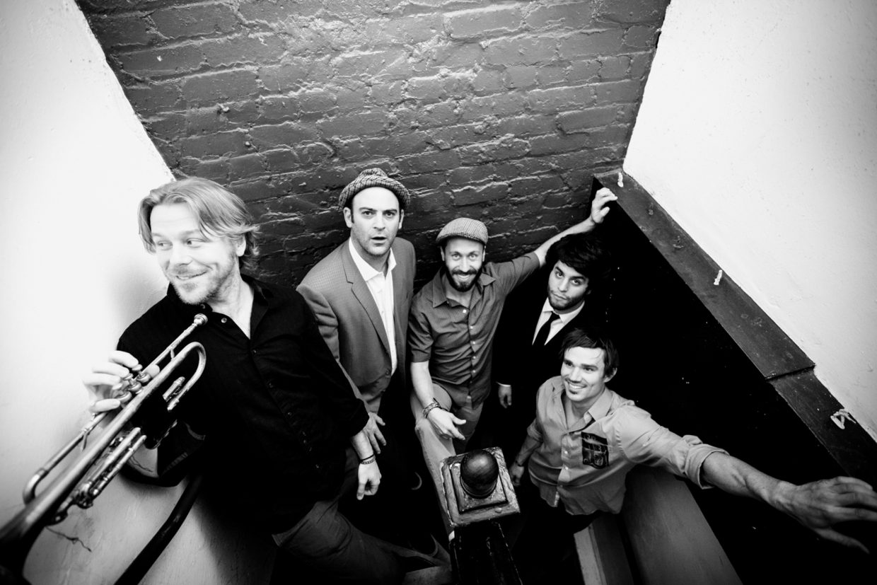 The California Honeydrops is comprised of members Lech Wierzynski as guitarist singer and trumpeter, drummer Ben Malament, Johnny Bones on tenor saxophone and clarinet, Lorenzo Loera on keys and melodica and Beau Bradbury on bass and percussion.