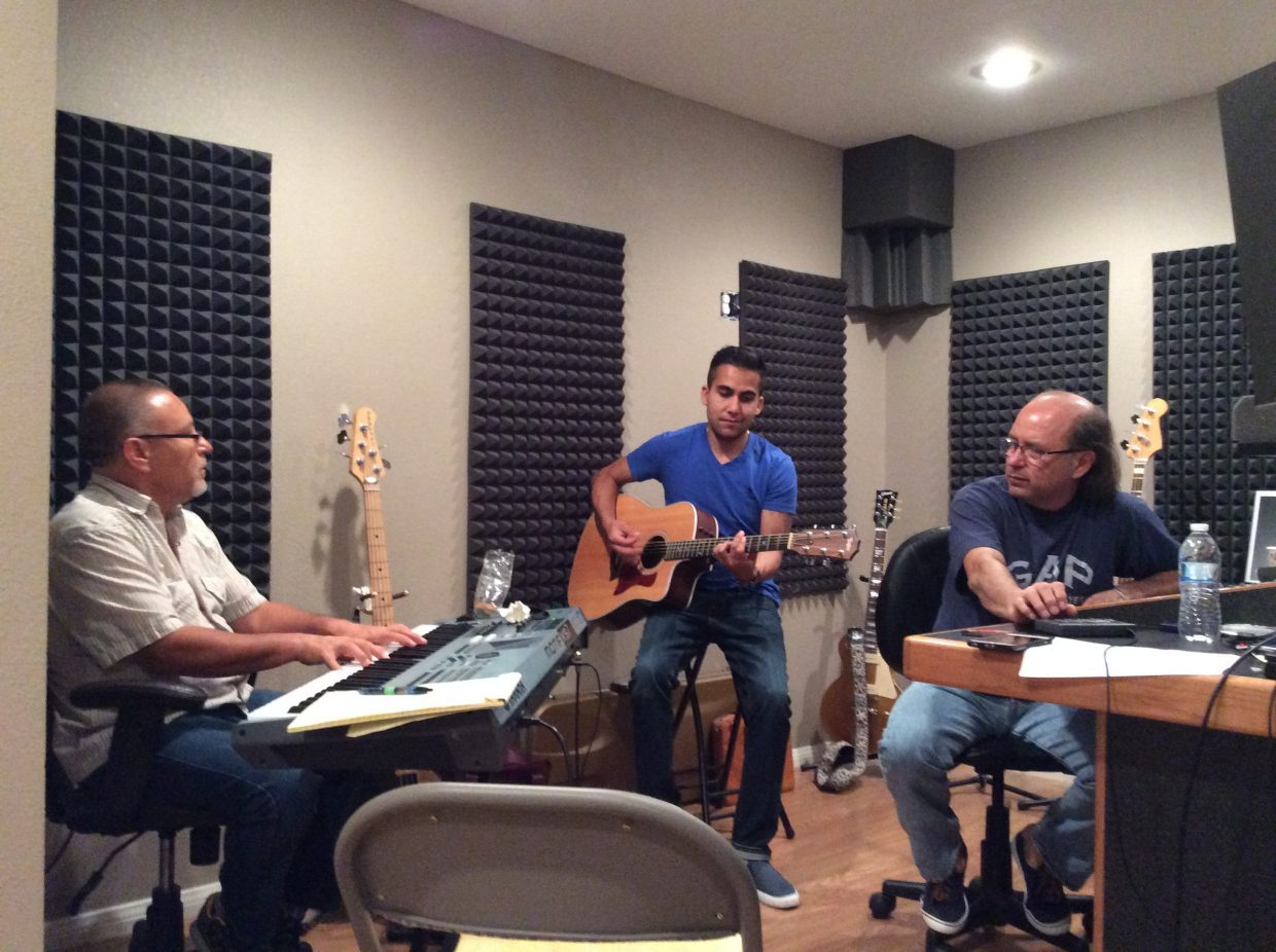 """Steamboat locals Jorge Gonzalez Avila and Caleb Campos created the musical, """"Maricopa el Musical"""" (Maricopa the Musical), which will premiere in Los Angeles. In this photo: Campos, playing guitar, Golfredo Bastida and Gilbert Bastida,who helped provide musical arrangements."""