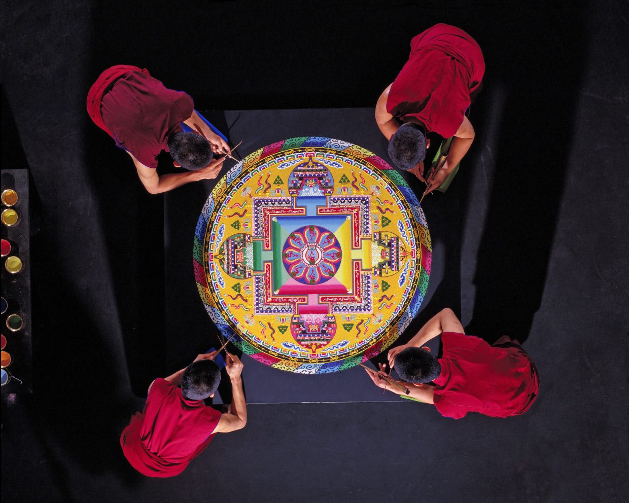 """For the first time since 2010, the Drepung Loseling monks will be back in Steamboat to create their mesmerizing mandala sand painting over the course of five days. This ancient art form also called dul-tson-kyil-khor, meaning """"Mandala of colored powders"""" is used as a tool for purifying and healing the environment and those who inhabit it. Each mandala the monks create in various communities they travel to is unique."""