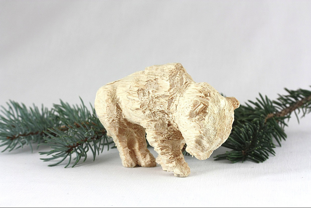 "Jerry Nelson's hand-carved wooden ornament of the ""Golden Buffalo"" represents the mascot of Wichita Southeast High School. The buffalo was carved to celebrate Nelson's children's graduation."