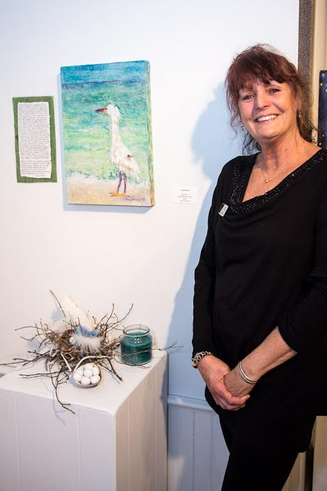 "Dona Steele with her mixed media piece ""Egret etc."""