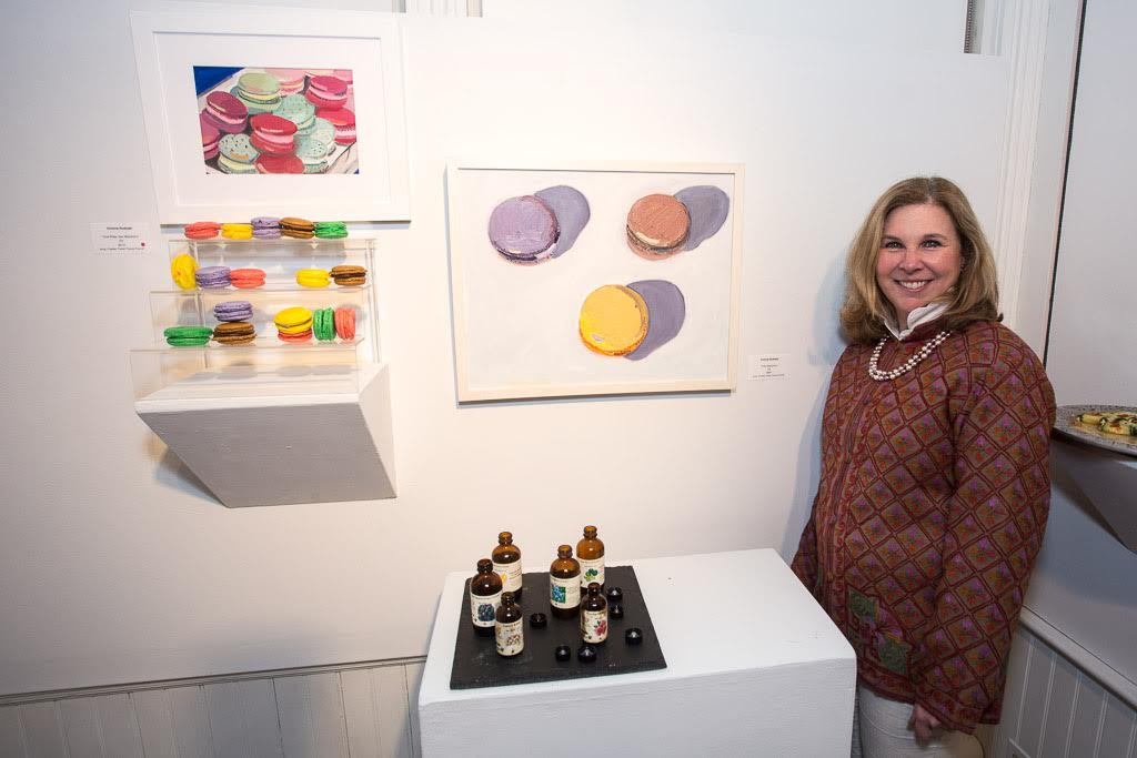 "Victoria Rudolph with her oil painting, ""Trios Macarons."""