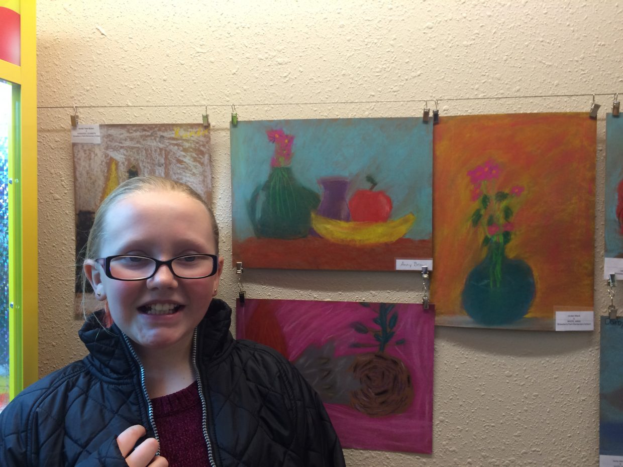 In this photo: Annika Brown at Celebration of Kids with her still life
