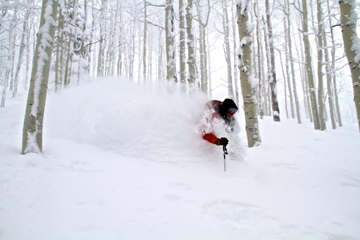 Mike Rakowski, a guide at Steamboat Powdercats for 27 years, shows his guests how to get after it in the aspen trees.