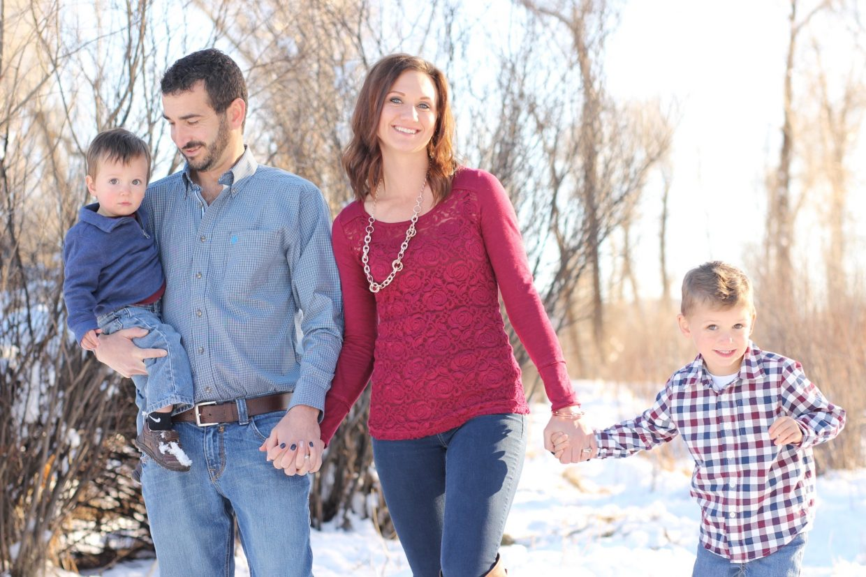 Danny, Mindy, Lleyton and Deegan Tea smile for their holiday photo that will be an example of the photography session available by the Yampa Valley Photography club this Saturday from 11 a.m. to 2 p.m.