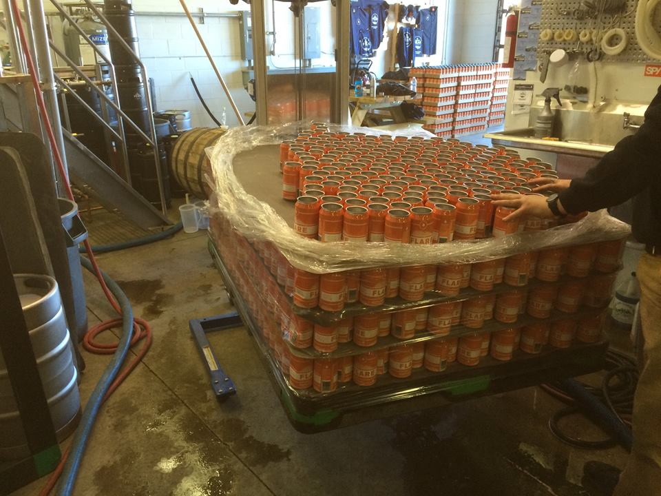 In this step of the process, cans are manually loaded off the pallet and placed in the twist rinser before being filled.