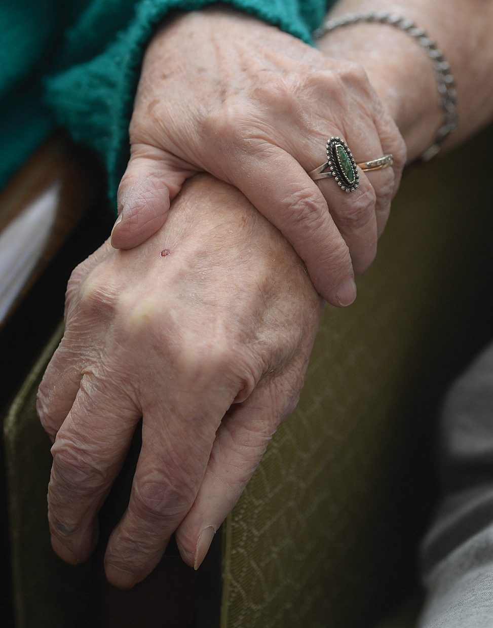 Barbara and Don Johnson, who live in the Doak Walker House, hold hands while recalling the 63 Valentines Days they have shared as husband and wife.