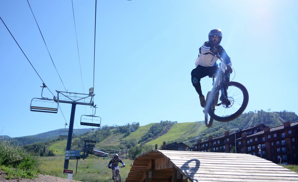 John Merwin gets some air on Bull Rider during Day 2 of the Endro-X downhill mountain bike series Sunday at the Steamboat Bike Park. The Enduro-X series will continue in a week for the Summit-X race, the final of the summer series.