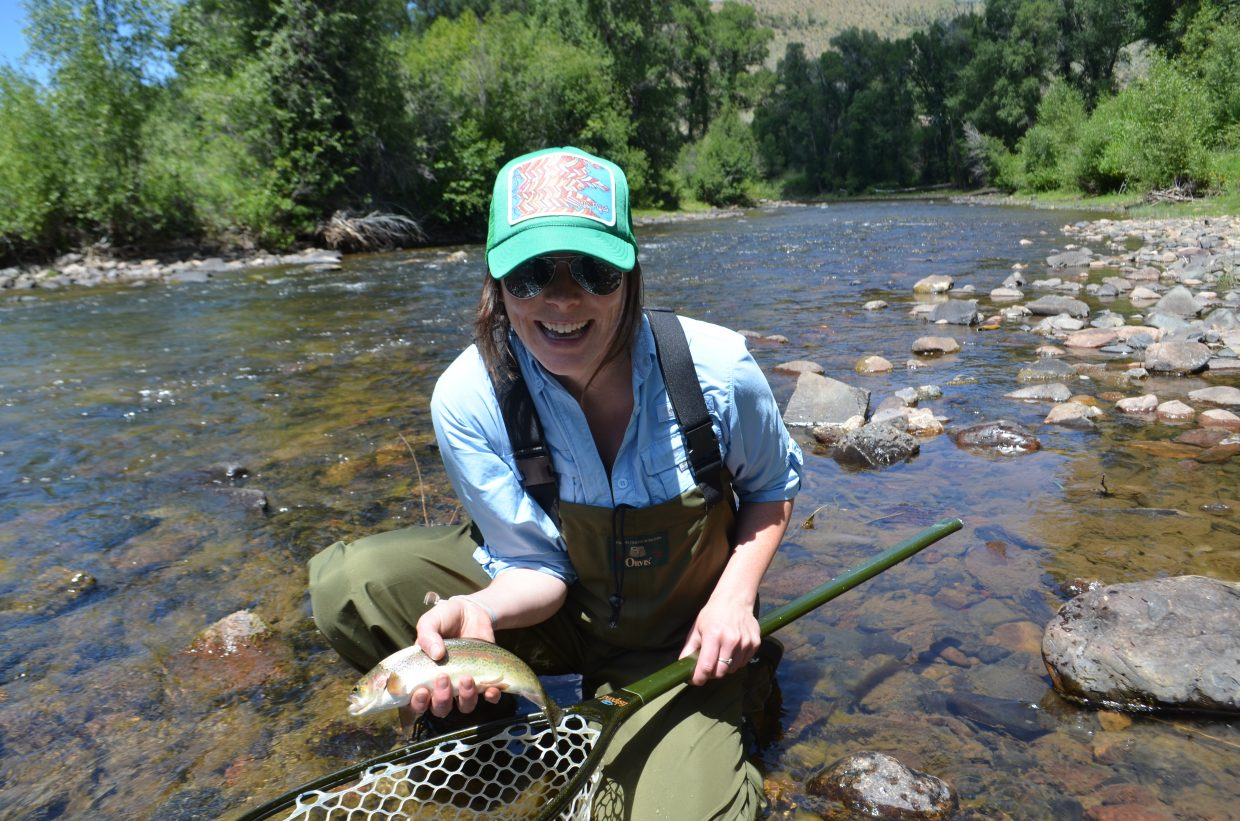 Arts and entertainment reporter, Audrey Dwyer, catches her first rainbow trout fly fishing on the Little Snake River.