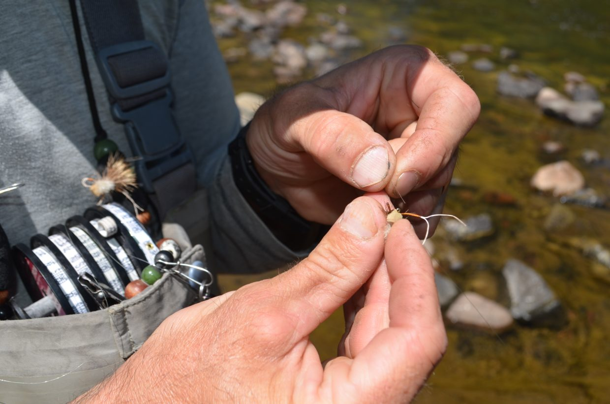 Brooklyn Outfitters guide, Andy Radzavich skillfully ties the hopper dropper fly onto the fishing line.