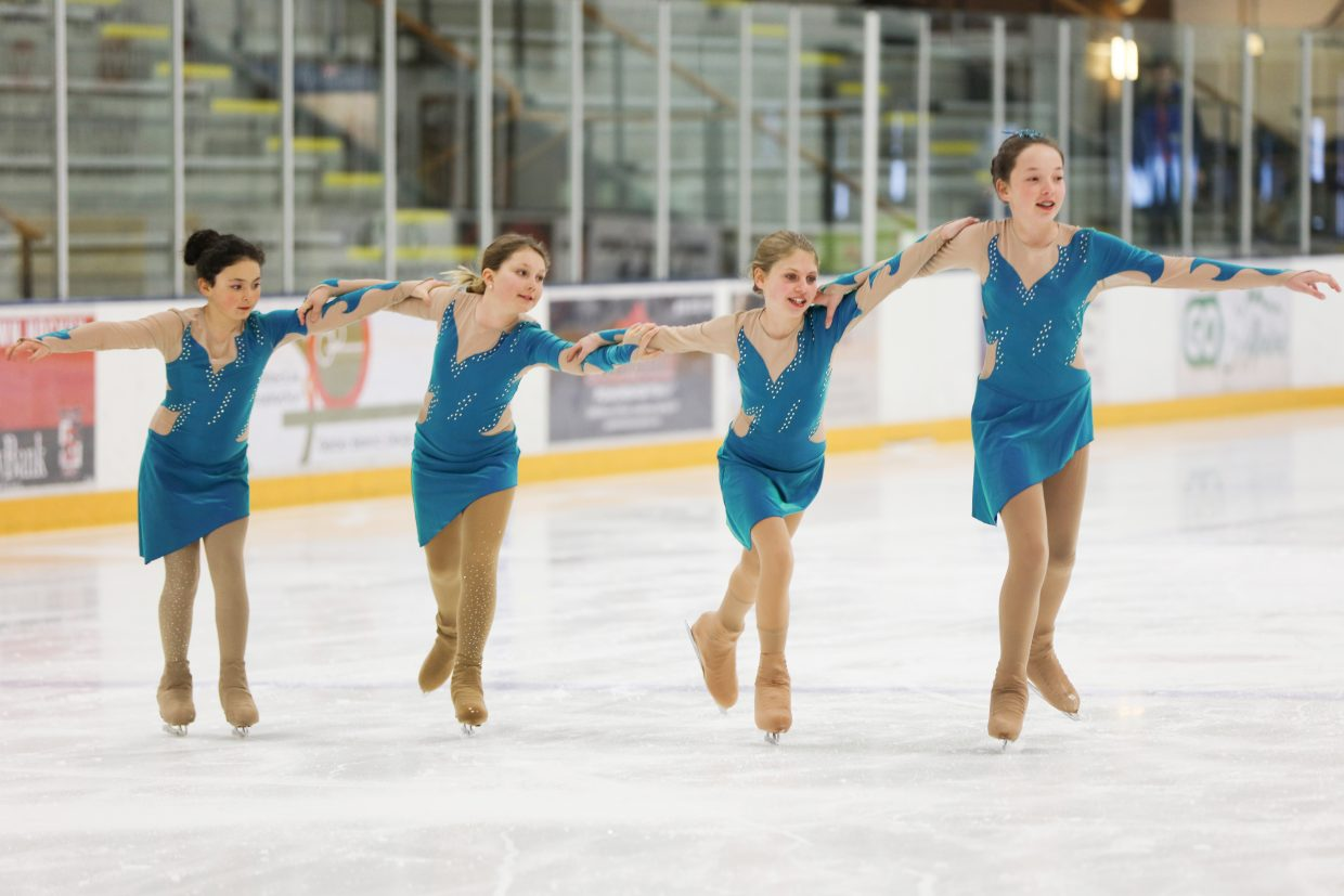 "Synchro team members Catherine Larock, Lily Frinks, Madison Van Engelenhoven and Natasha Curzon skate to ""Caribbean Blue"" by Enya during Thursday's dress rehearsal."