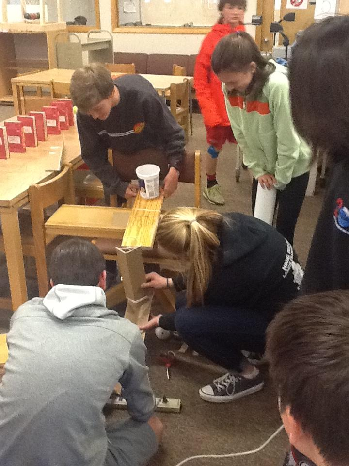 """MakerSpace students Cooper Jones and Maggi Conydon work on their """"rube goldberg machine"""" for this Saturday's Maker Faire event, a family-friendly festival of invention, creativity and celebration of the Maker movement."""