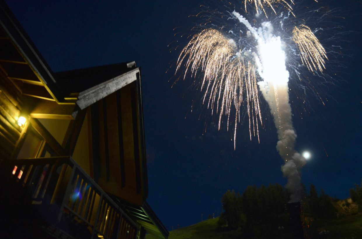 Early Fourth of July fireworks erupt over Olympian Hall at Howelsen Hill Friday night.