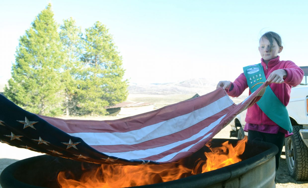 Steamboat Springs Girl Scout Taylor Graham retires a flag on Sunday.