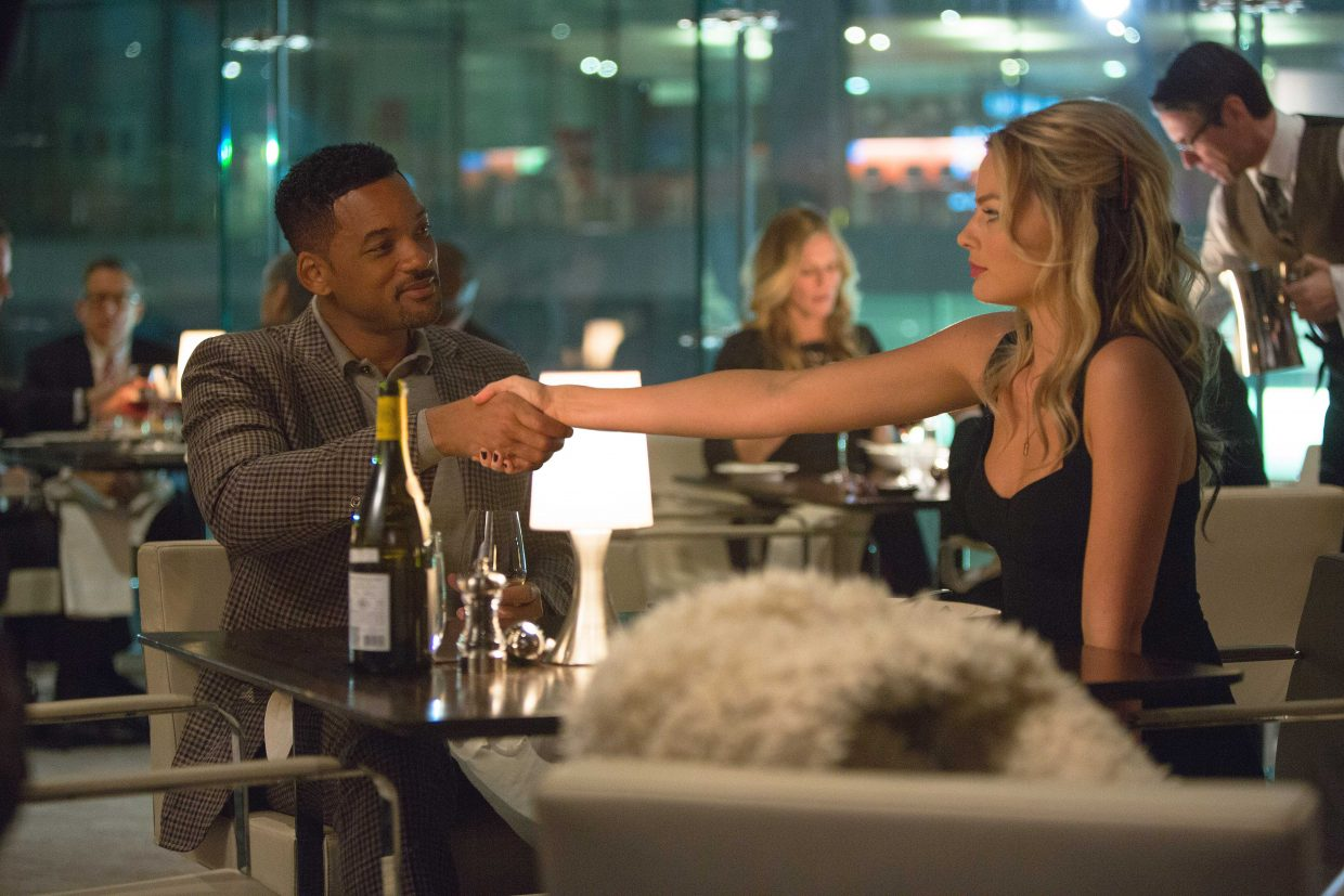 """Nicky Spurgeon (Will Smith) meets Jess Barrett (Margot Robbie) in """"Focus."""" The movie is about an experienced con man who trains and reluctantly fall in love with a young thief."""