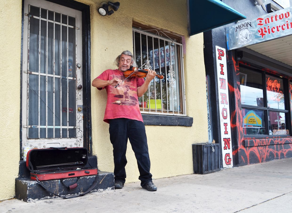 This image was captured on Fourth Street in Tucson, a funky shopping district that reminds me in some ways of one of my old haunts, State Street in Madison, Wis. The violinist's expressive face reminded me of Joe Cocker.