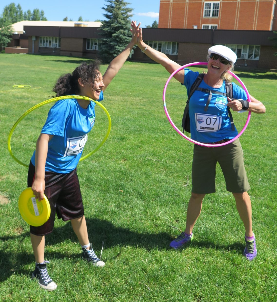 Toni Hennessy and Nicole participate in the Frisbee Hoopla challenge.