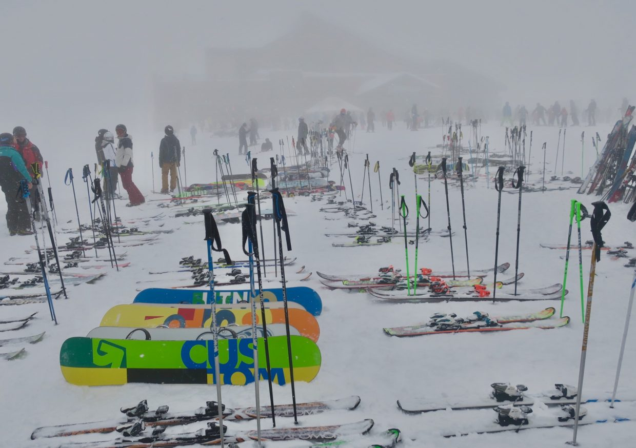 Rush hour: Skis and snowboards pile up in front of Thunderhead Lodge on Wednesday at Steamboat Ski Area. Snowy conditions limited visibility on the mountain but didn't deter skiers.