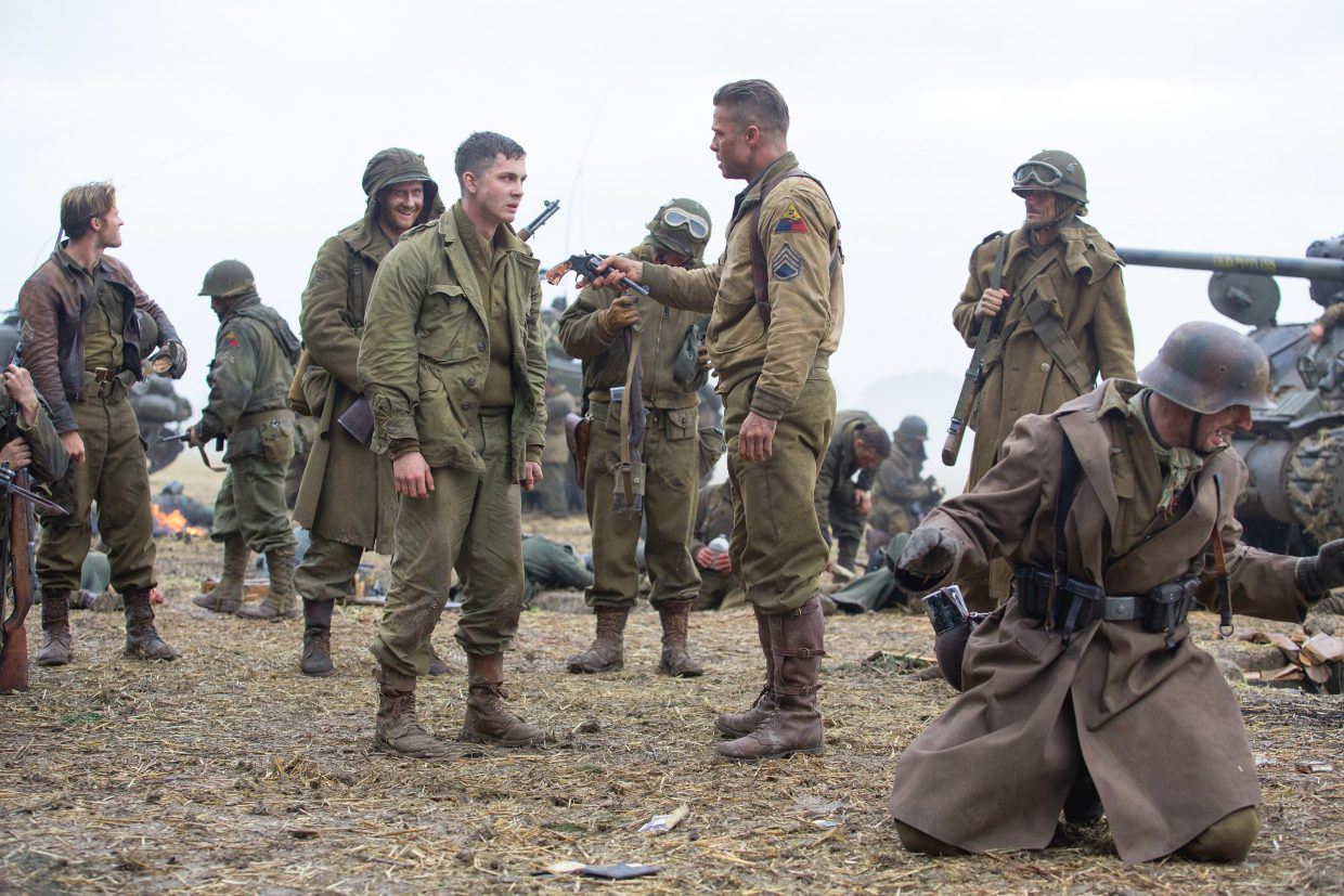 """Staff Sgt. Don """"Wardaddy"""" Collier (Brad Pitt) imposes a show of loyalty on Pvt. Norman Ellison (Logan Lerman) in """"Fury."""" The movie is about a platoon of tanks in the last days of World War II."""