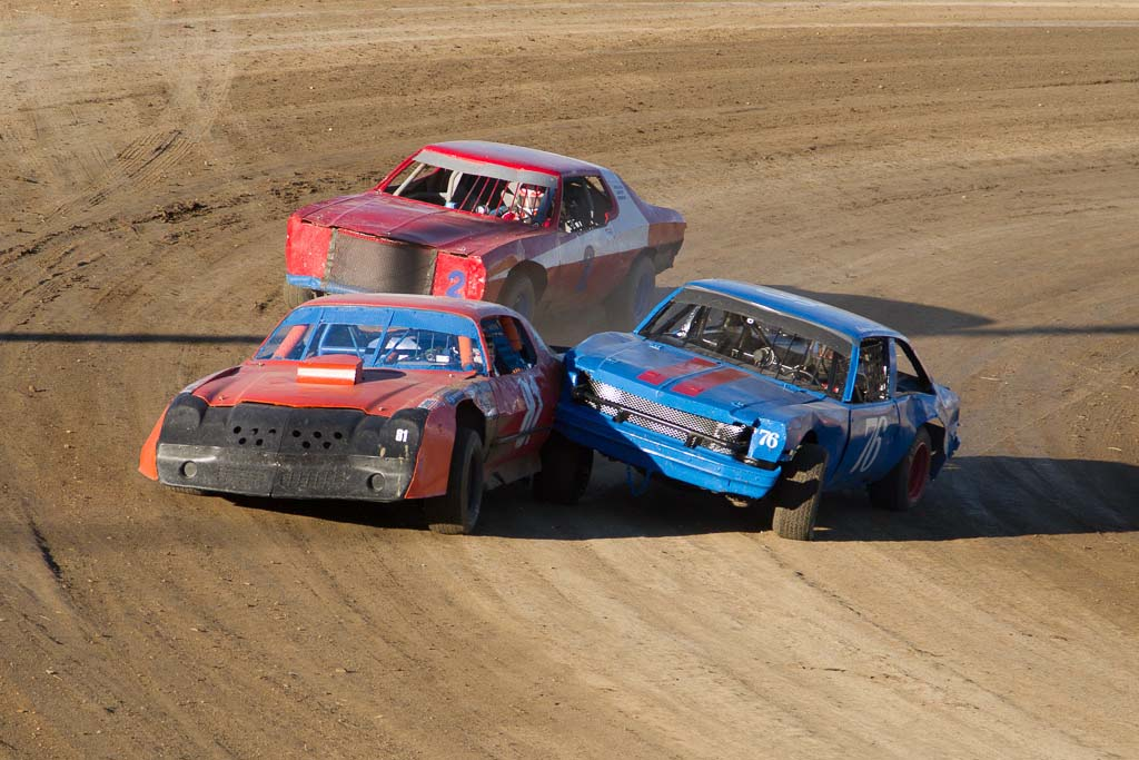 Burt George (81) of Steamboat is tagged from behind in the Stock class heat at Hayden Speedway Saturday night. George went on to win the feature race. Submitted by George Fargo.