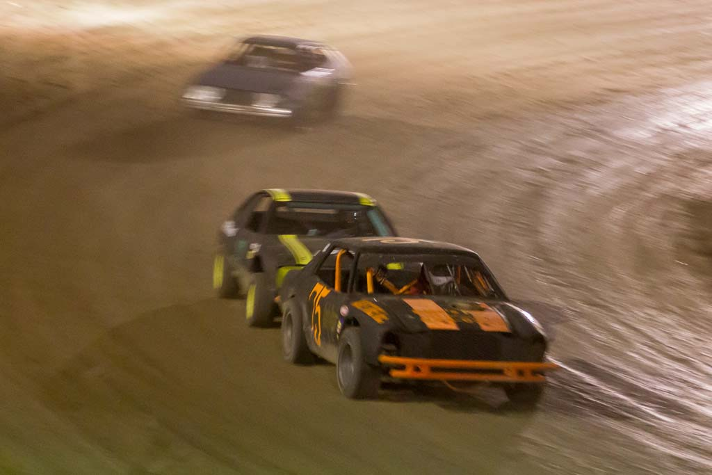 Mike Battaglia (75) of Craig leads in nose to tail action in the Outlaw Mini feature race at Hayden Speedway Saturday night. Submitted by George Fargo.
