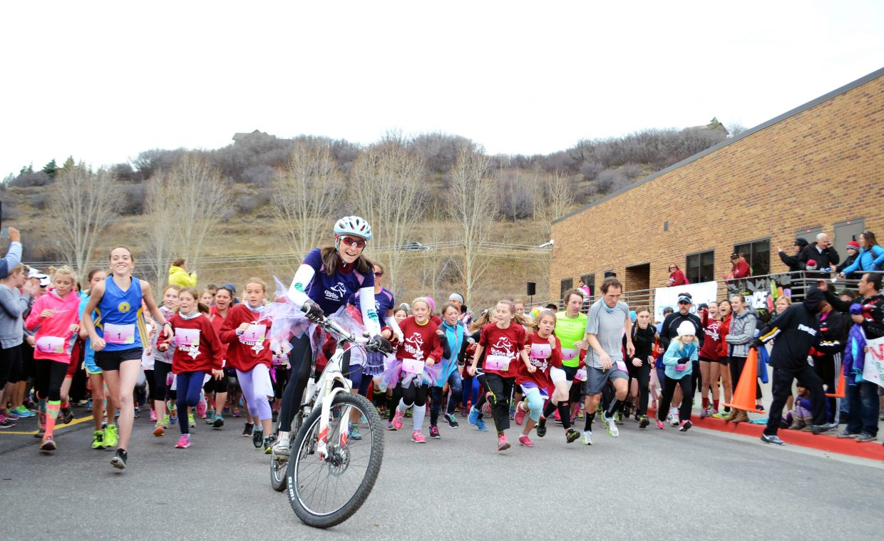 The Western Colorado Girls on the Run participants take off Saturday from Strawberry Park Elementary School. Hundreds of girls, boys, women and men took on the 5K. The event is designed to inspire girls to tap their full potential and pursue their dreams.