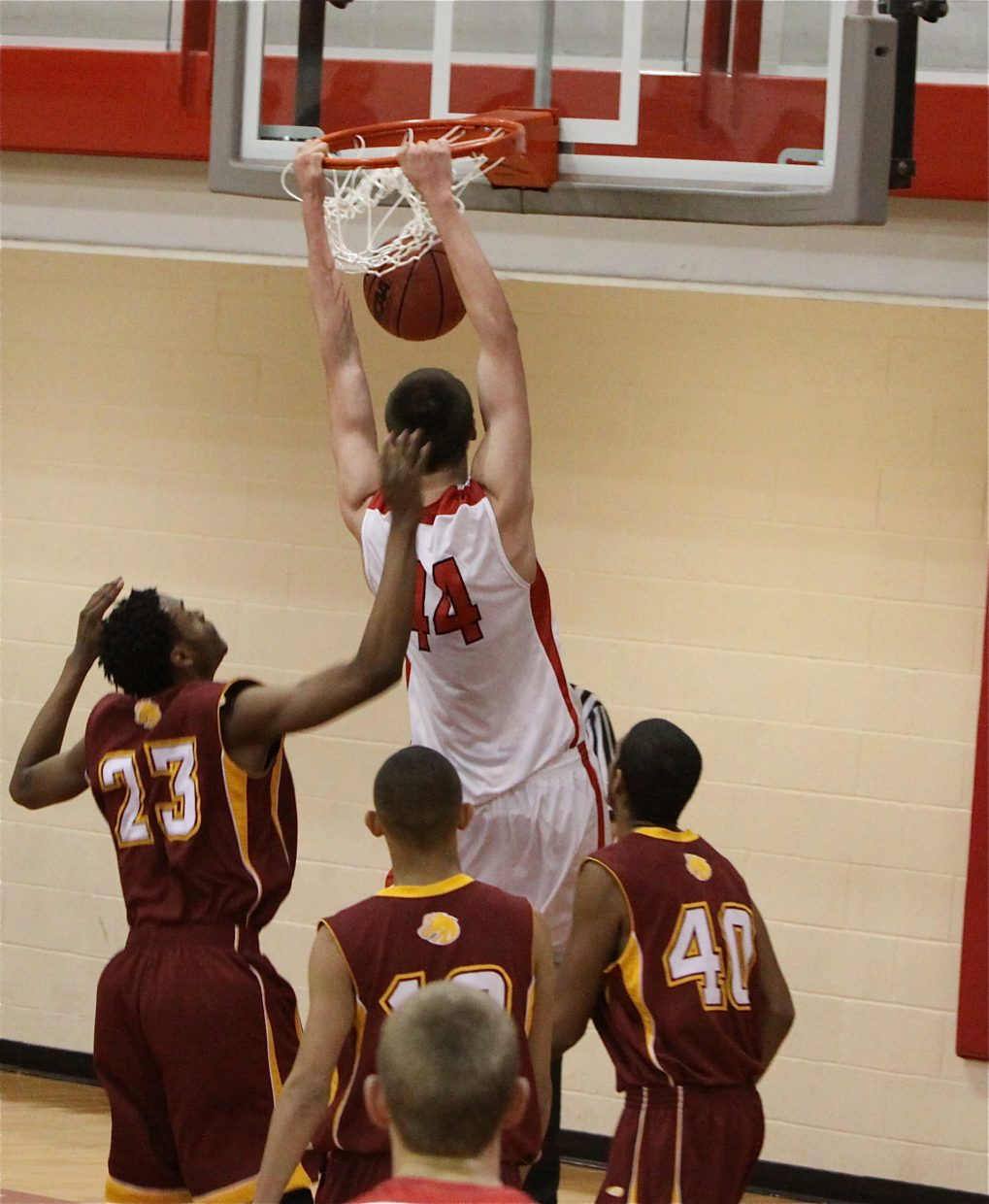 Garrett Bye dunks one at Wednesday's game over Sierra's Michael Jordan. Submitted by: Mark McCaulley