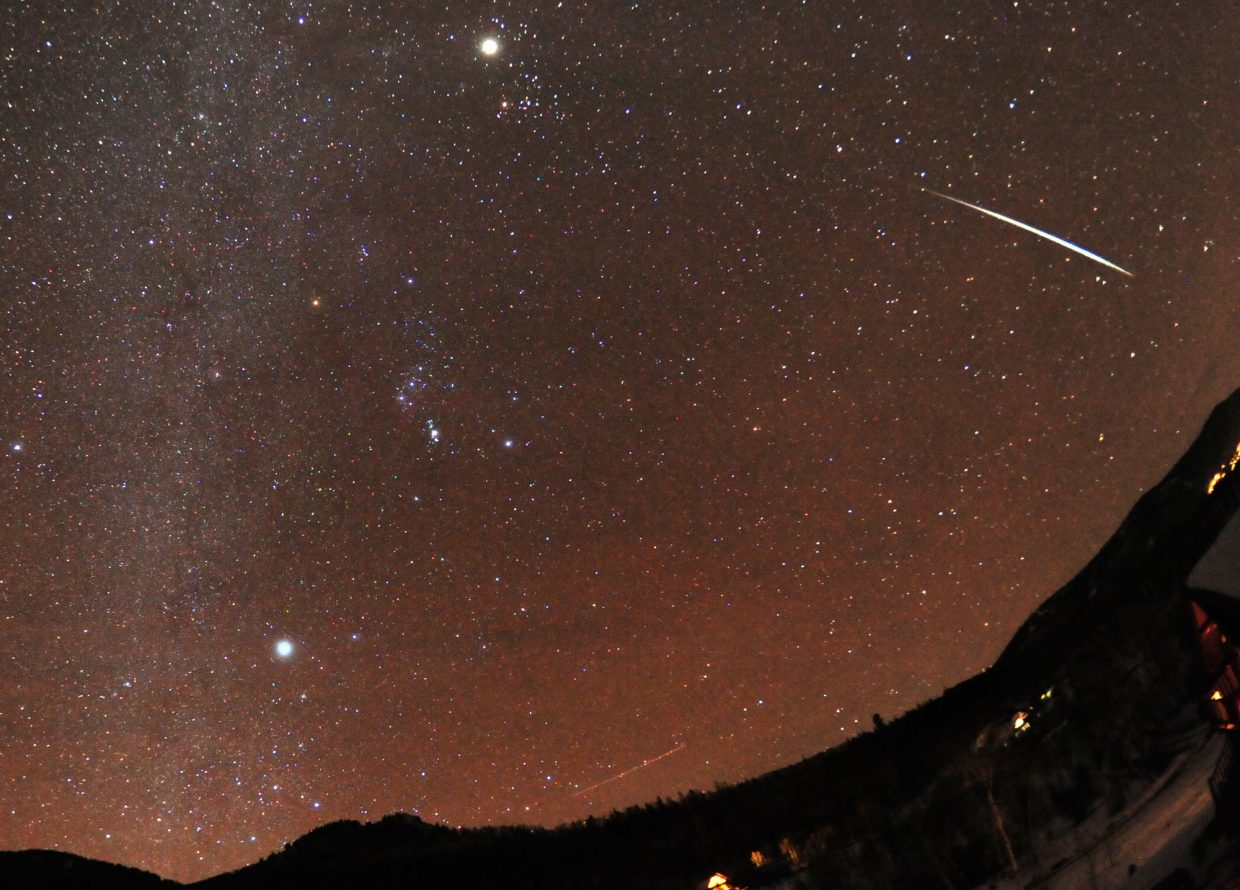 The annual Geminid meteor shower peaks this weekend, bringing as many as 120 shooting stars an hour to the sky. This bright Geminid fireball was captured streaking through the sky Dec. 14, 2012. The constellation of Orion appears left of center, and the planet Jupiter is the bright object near the top. Geminid meteors can be seen any night this week, but the peak of activity will come this weekend.