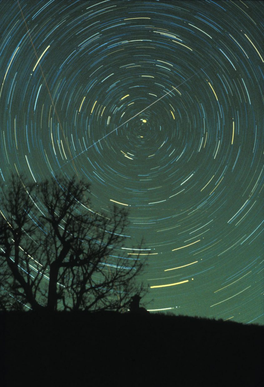 The annual Geminid meteor shower is rising this week toward its peak of activity next weekend. Geminid meteors seem to spring from our constellation of Gemini, the Twins, and streak across the sky in all directions. Watch for Geminid meteors any time between 8 p.m. and dawn, with the hours from midnight to dawn being the most active. In this image, taken Dec. 14, 1985 from Brasstown Bald Mountain in northern Georgia, a bright Geminid meteor left its long streak across the one-hour time exposure.