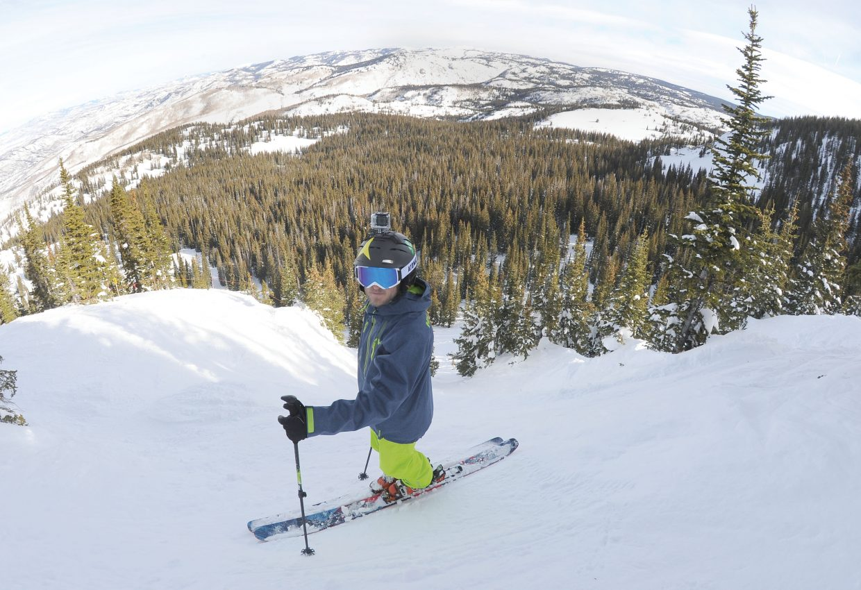 Mike Maroney stands at the top of the chutes at the Steamboat Springs ski area. Maroney likes to ski in Colorado's back-country and taking his GoPro to record his adventures and to share them has become second nature.