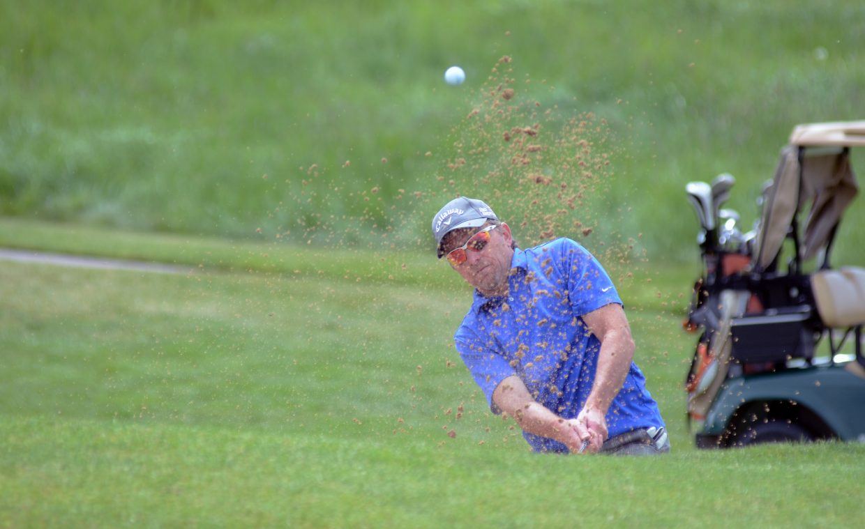 Chris Catterson fights out of a bunker near the No. 2 green Saturday at Haymaker Golf Course as part of the Ski Town USA Golf Classic.