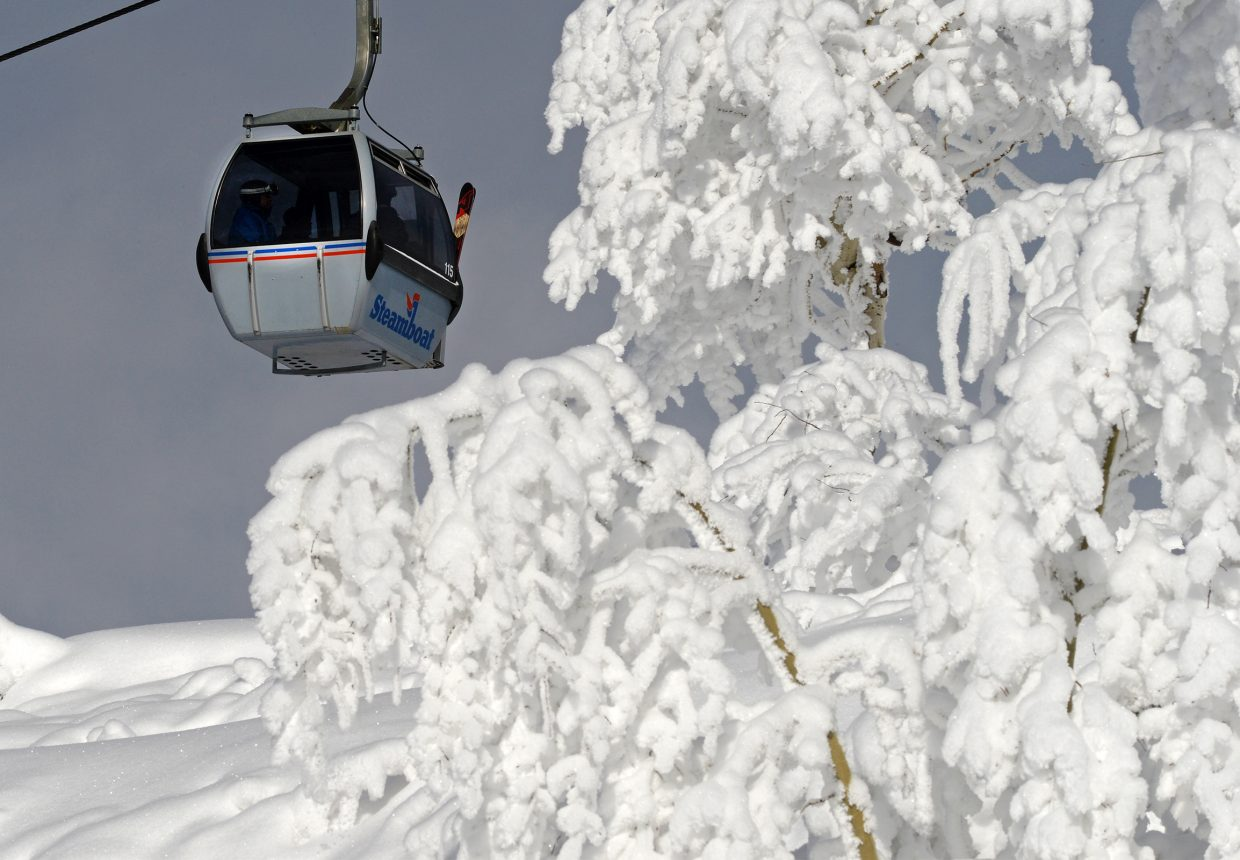 Fresh snow covers the trees at Steamboat Ski Area Wednesday afternoon as the gondola car makes its way to the top of the mountain.