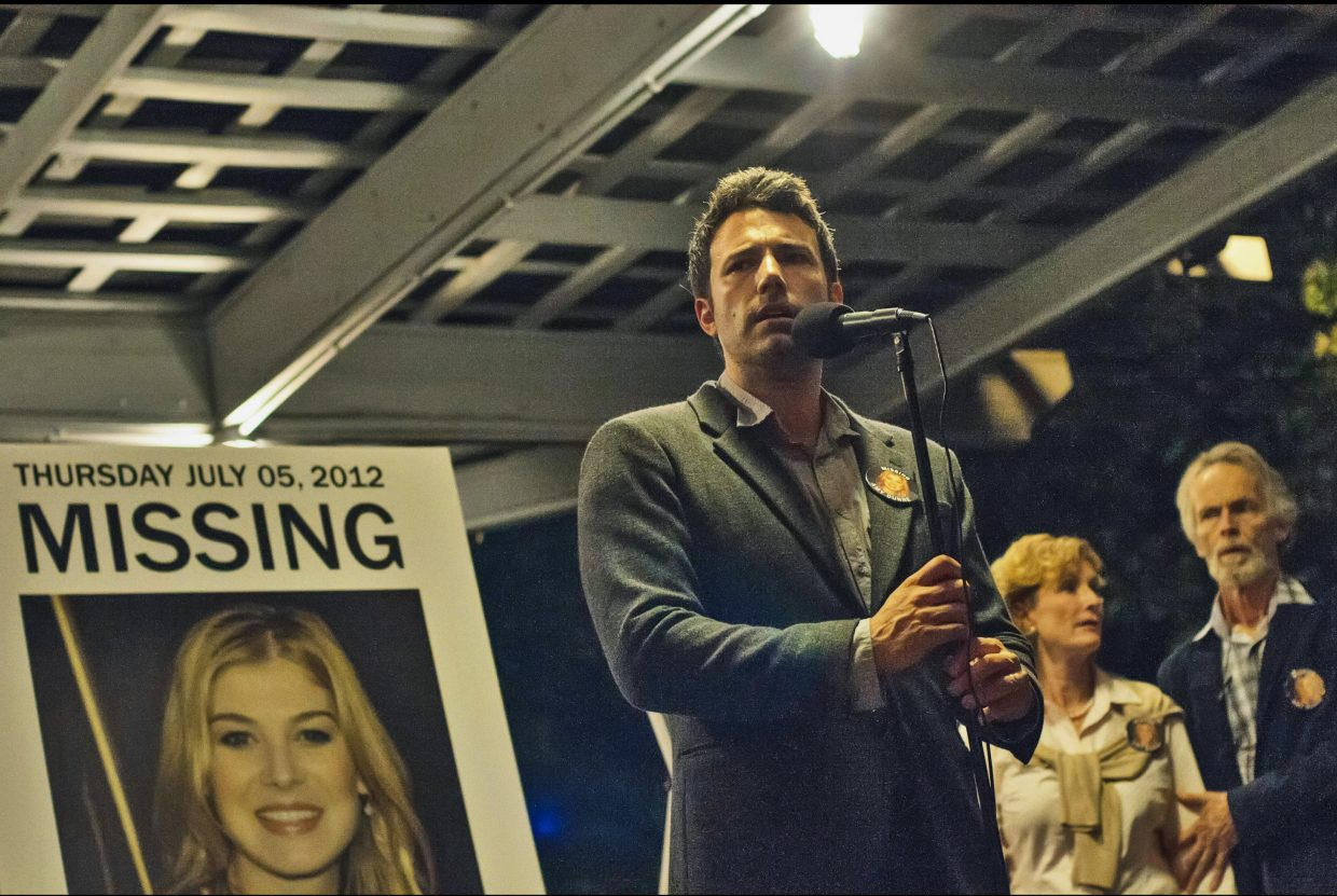 """Nick Dunne (Ben Affleck) appeals to a crowd to help him find his wife, Amy, in """"Gone Girl."""" The movie is based on the book about a missing woman who appears to have been abducted but may have been murdered by her husband."""