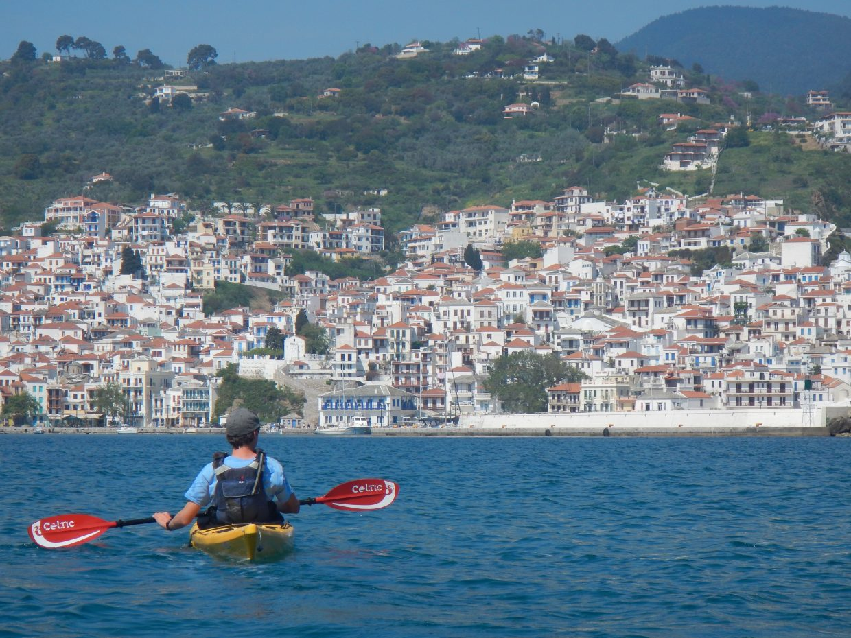 A student on the Global Immersion Studies' Greece trip kayaks through the sea.