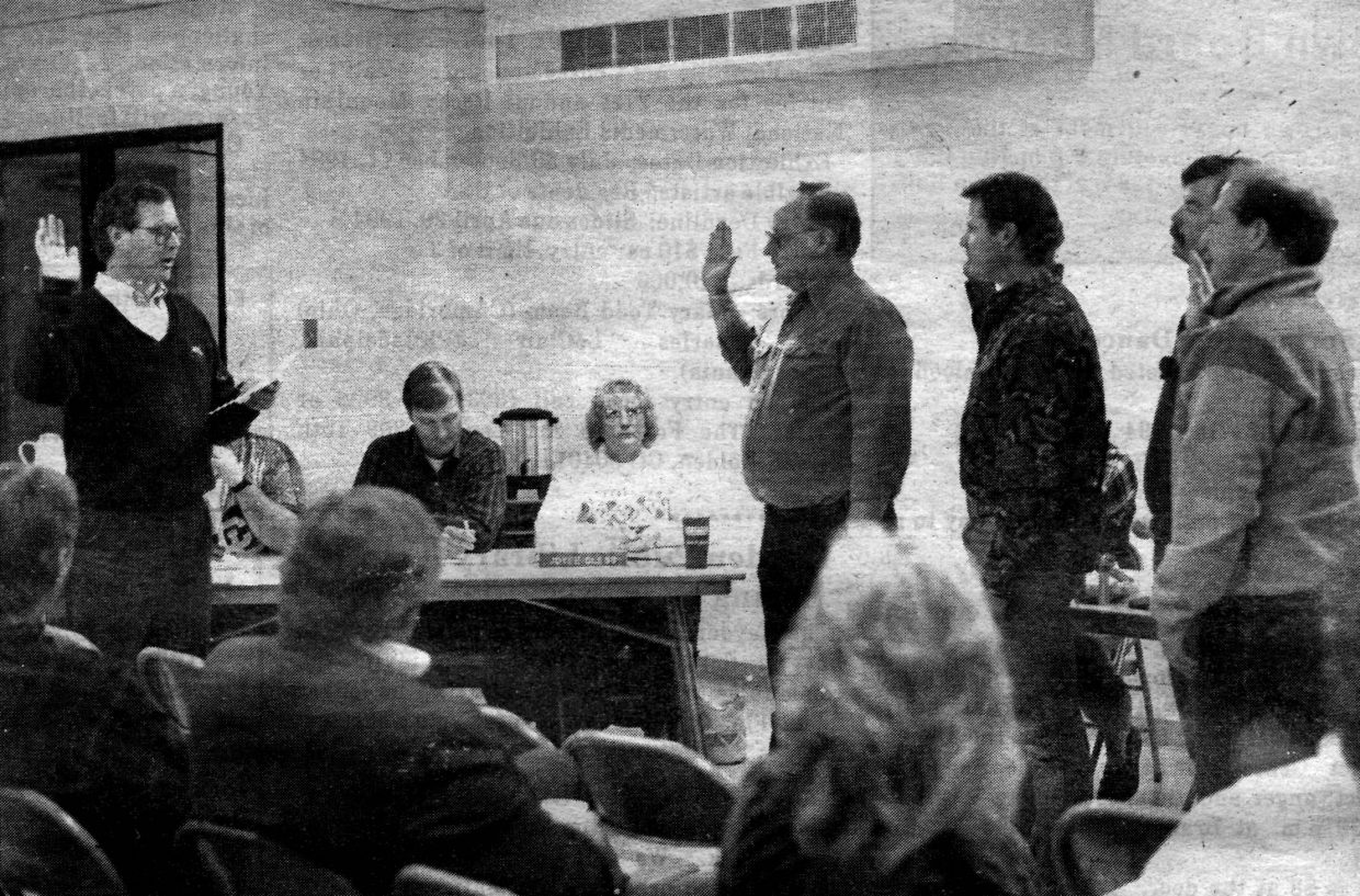 """Mark Fisher, left, swears in former Hayden Mayor Richard """"Dick"""" Roberts, and other town trustees in April 1994."""
