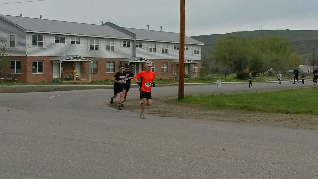2014 Cog Run 5k top men: Paul Hughes (1st), Tyler Terranova (2nd) and Evan Barbier (3rd). Submitted by David Torgler.