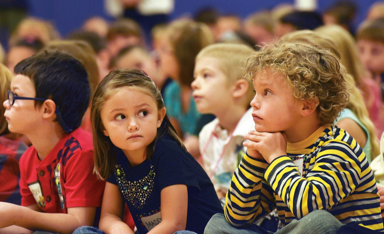 Hayden Valley Elementary School students Silas Morrison and Madelyn Debeak listen during an assembly on the first day of school last fall. How young children are faring in the United States is the topic of a television documentary screening Tuesday at the Bud Werner Memorial Library.
