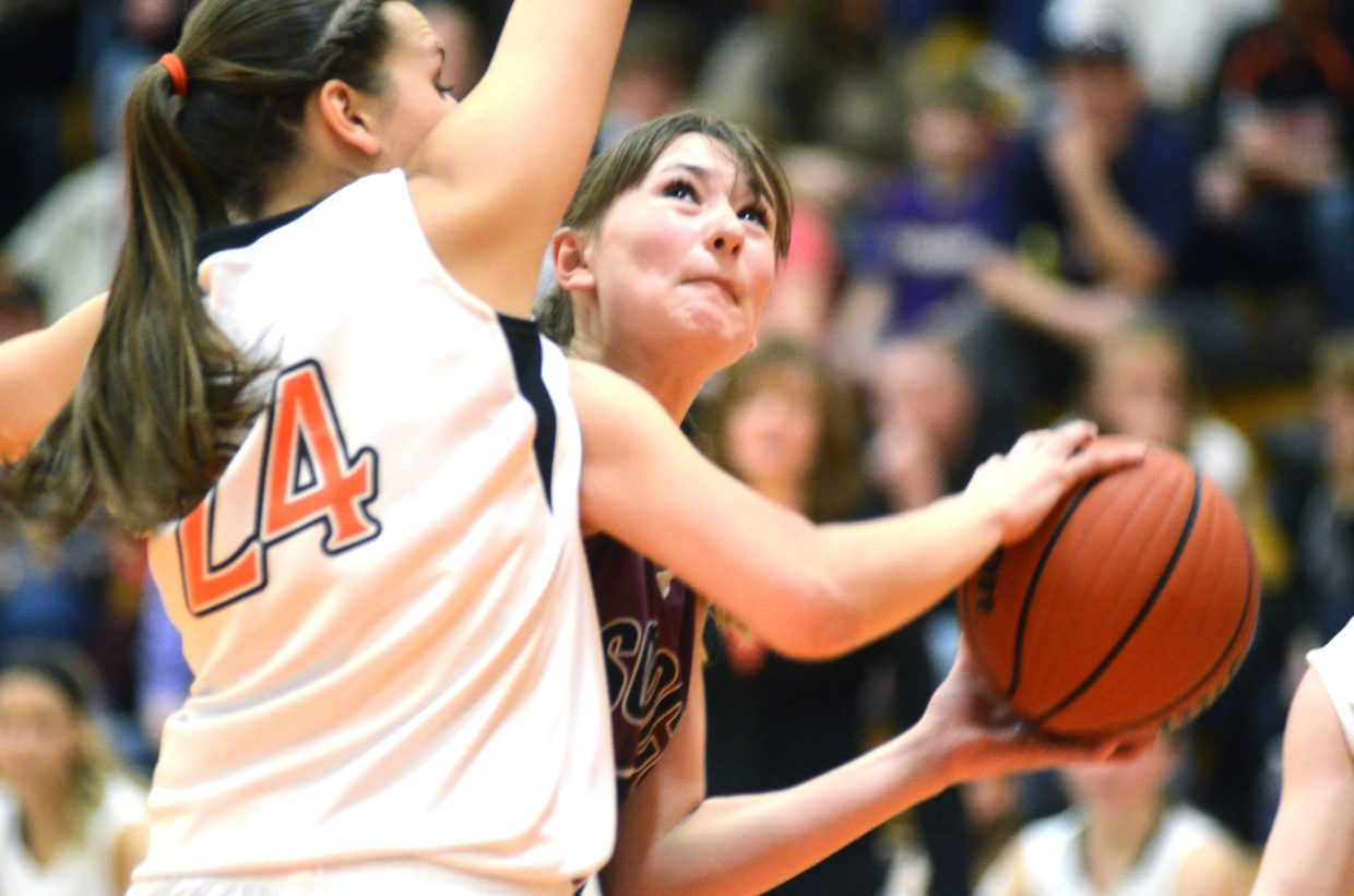 Soroco's Briana Peterson looks for an opening around a Hayden defender in the Rams' conference victory Friday night.