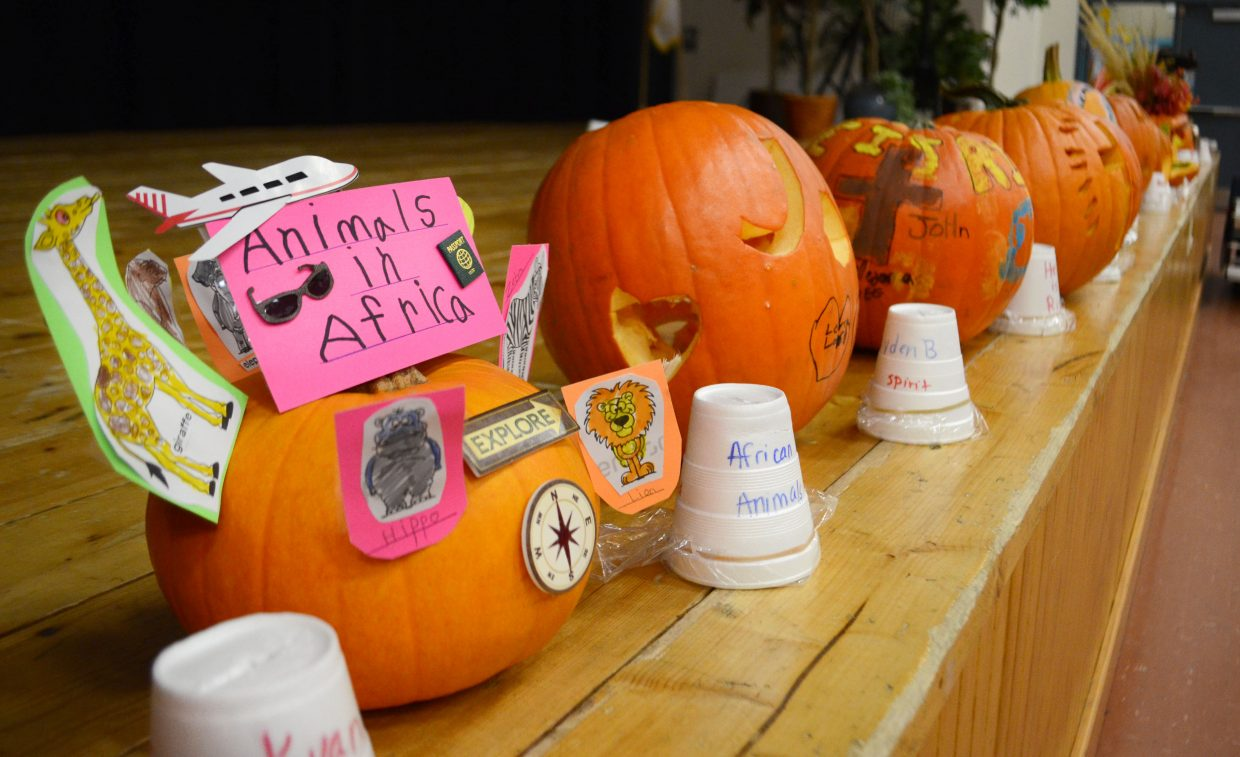 """""""Around the World"""" themed pumpkins were on display Friday at Heritage Christian School during its annual fall festival. As students jumped from activity to activity, they were asked to vote on their favorite pumpkin decorations."""